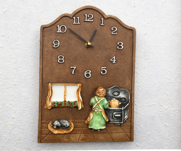 Wall clock grandma at the stove